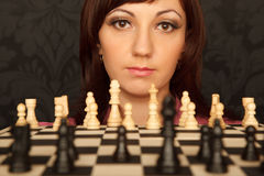 Portrait of girl in red shirt with chessboard Stock Photo
