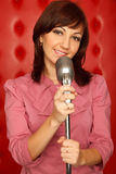 Portrait of girl in red shirt with microphone Stock Image
