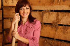 Portrait of girl in red shirt standing in hayloft Royalty Free Stock Photos