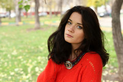 Portrait of a girl in a red sweater Stock Photo