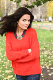Portrait of a girl in a red sweater Stock Images
