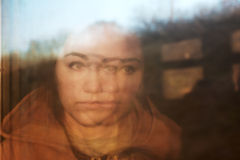 Portrait of girl, reflected in window of train Stock Photography