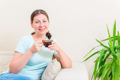 Portrait of  girl relaxing with a cup Royalty Free Stock Images