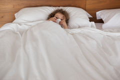 Portrait of a girl resting in bed Royalty Free Stock Image