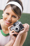 Retro woman with old-fashioned camera Royalty Free Stock Image