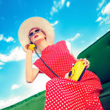 Portrait of a girl in a retro style with a phone. Fashion portrait of a girl in a retro style with a phone Royalty Free Stock Photography