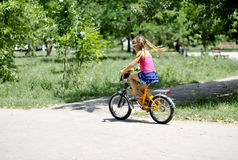 Portrait of a girl riding a bicycle Royalty Free Stock Images
