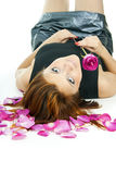 Portrait of girl with a rose and petals Stock Photography