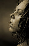 Portrait of a girl's face which water flows Royalty Free Stock Images