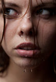 Portrait of a girl's face which water flows Royalty Free Stock Photos
