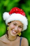 Portrait girl in santa claus hat Royalty Free Stock Photos