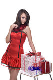 Portrait of girl in santa dress with gifts Royalty Free Stock Photo