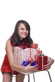 Portrait of girl in santa dress with gifts. Close up portrait of emotional girl in santa claus dress, white fur and some gifts Stock Photo