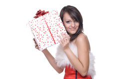 Portrait of girl in santa dress with gifts. Close up portrait of emotional girl in santa claus dress, white fur and some gifts Royalty Free Stock Photos