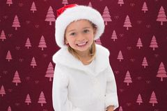Portrait of girl in santa hat during christmas time Royalty Free Stock Images