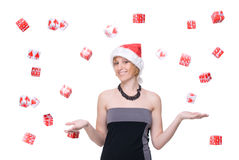 Portrait of girl in santa hat over gift fall Stock Photos