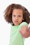 Portrait of a girl saying stop with her hand Stock Photos