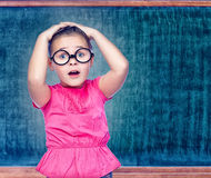 Portrait of a girl schoolgirl costs about Chalkboard Royalty Free Stock Photos