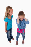 Portrait of a girl screaming at her friend. Against a white background Stock Images