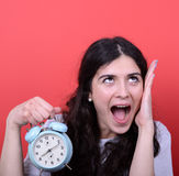 Portrait of girl screaming while holding clock royalty free stock images