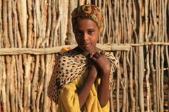 Portrait of a girl in search of water at sunrise. Ethiopia