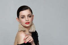 Portrait of a girl with self-made earrings made of string Royalty Free Stock Photography