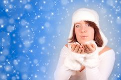 Portrait of girl sending kiss on snow Royalty Free Stock Image