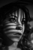 Portrait of girl with shadows on her face Royalty Free Stock Photography