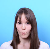 Portrait of girl with shock gesture against blue background Royalty Free Stock Photography