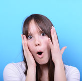 Portrait of girl with shock gesture against blue background Stock Photography