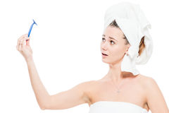 Portrait of a girl after shower with a razor on white Stock Images