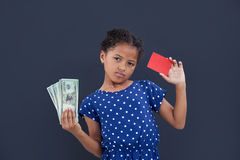 Portrait of girl showing currency and credit card Royalty Free Stock Photos