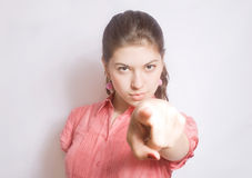 Portrait of the girl, showing a finger. Royalty Free Stock Photos