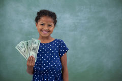 Portrait of girl showing paper currency Royalty Free Stock Images