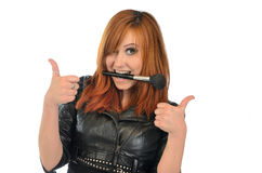 Portrait of a girl that shows thumbs up near white background Royalty Free Stock Photos