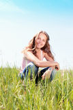 Spring Girl. Portrait girl sits on a grass Royalty Free Stock Photo