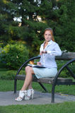 Portrait of girl sitting on the bench Stock Photography