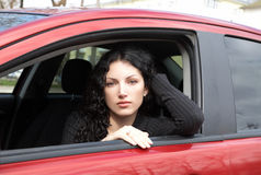 Portrait of the girl sitting in  car Royalty Free Stock Photos