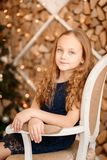 Portrait of girl sitting on chair Royalty Free Stock Image