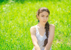 Portrait of a girl sitting on grass. Stock Photos