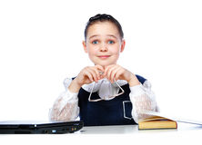Portrait of a girl sitting at a school desk, school, classroom, Royalty Free Stock Images