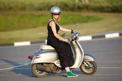 Portrait of a girl sitting on scooter Royalty Free Stock Photos