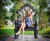 Portrait of a girl sitting on the throne Royalty Free Stock Photo