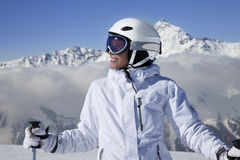 Portrait of girl skier. Young pretty girl skier on the peak of mountain stock photos