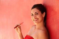 Portrait Girl Smiles Electronic Cigarette E-Cig Against Red Back Stock Photos