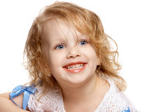 Portrait of a girl, smiling. Girl smiling, showing her teeth Royalty Free Stock Image