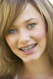 Portrait Of Girl Smiling. Portrait Of Girl With Braces Smiling To Camera Stock Photo