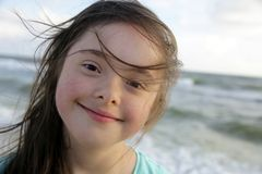 Portrait of the girl smiling on background of the sea stock photos