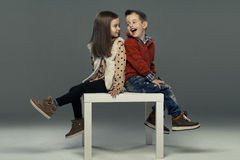 A portrait of a girl and a smiling boy. Royalty Free Stock Photos