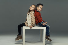 A portrait of a girl and a smiling boy. Stock Photo